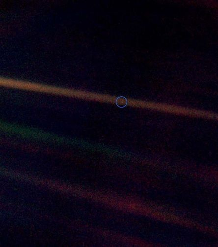 Figure 1: Earth, the pale blue dot, as seen by Voyager 1.